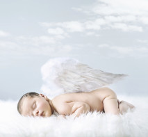 Portrait of a little baby as an angel
