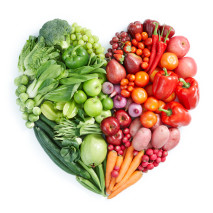 Heart shaped display of green, red healthy foods